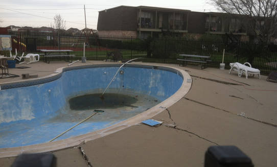 How to drain an inground pool with a hose